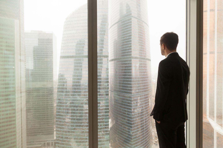 Man standing in window