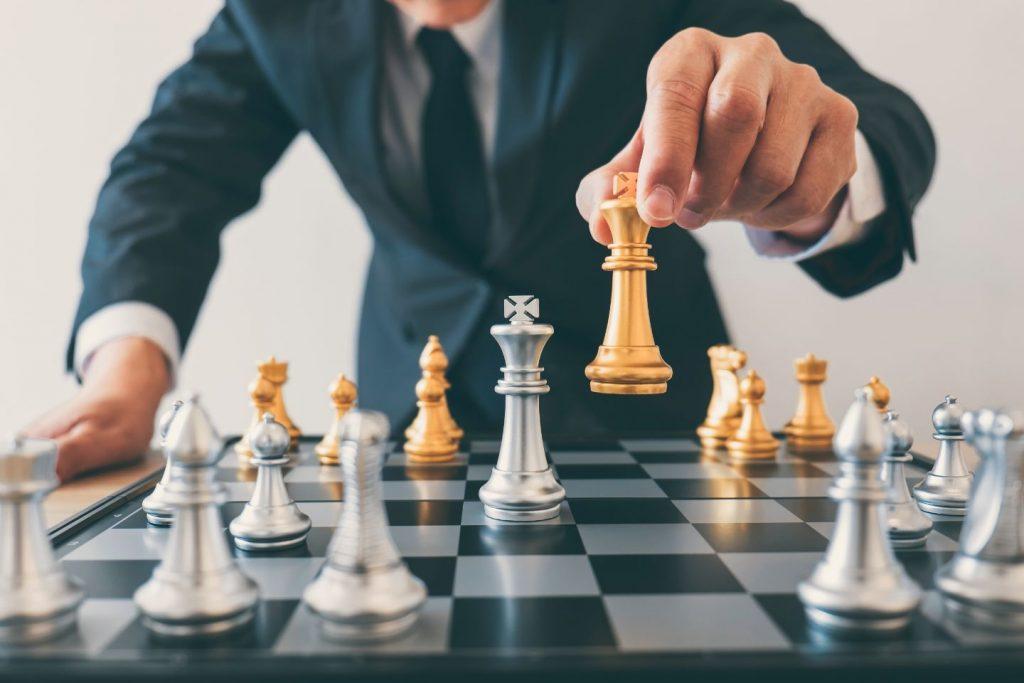 Man moving chess piece
