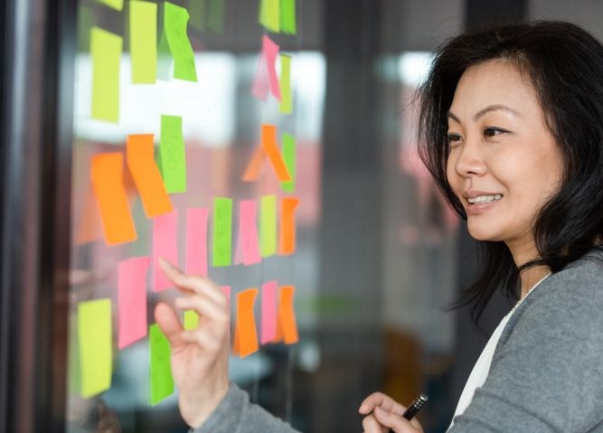 Woman using sticky notes